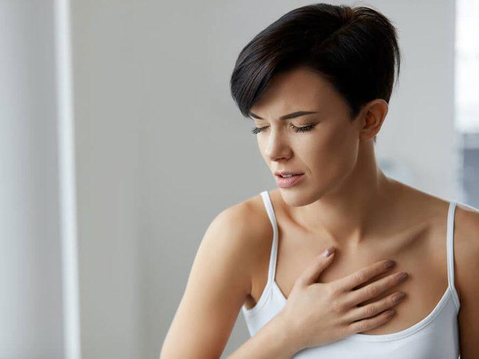 genetics - woman holding heart