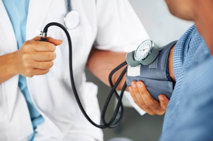 Boost Male Fertility | Doctor checking man's blood pressure