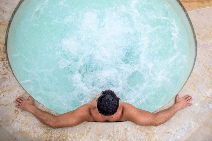 Boost Male Fertility | man in a whirlpool hot tub