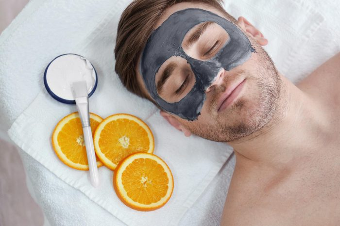 reclining man with a face mask at a spa