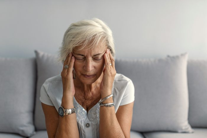 woman suffering from painful headache