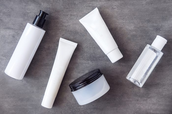 Bottles, tubes and jars with natural skincare beauty products from above.