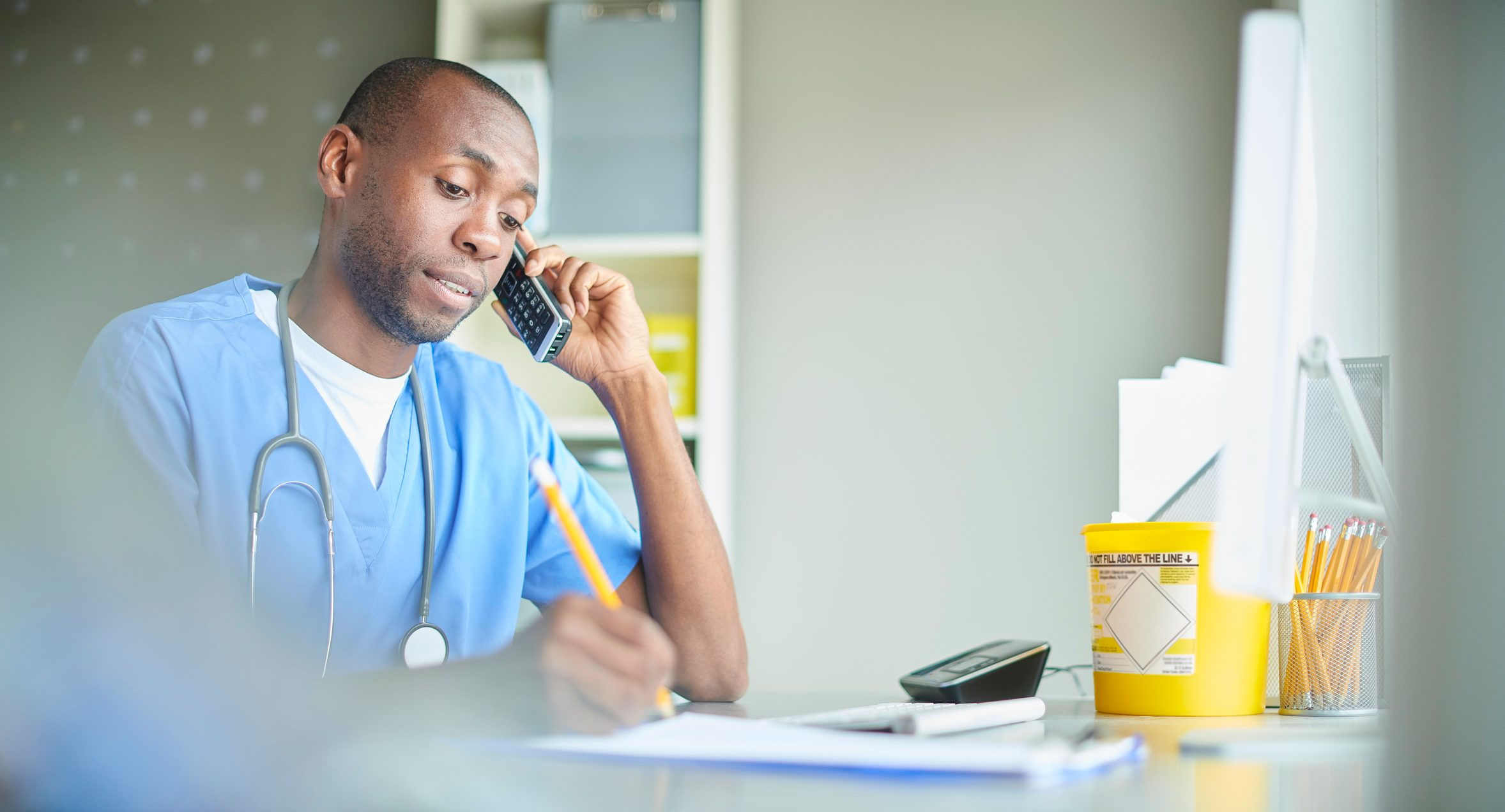 male doctor on the phone with patient