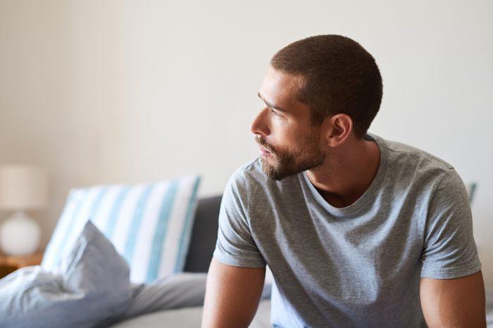 man sitting at home thinking
