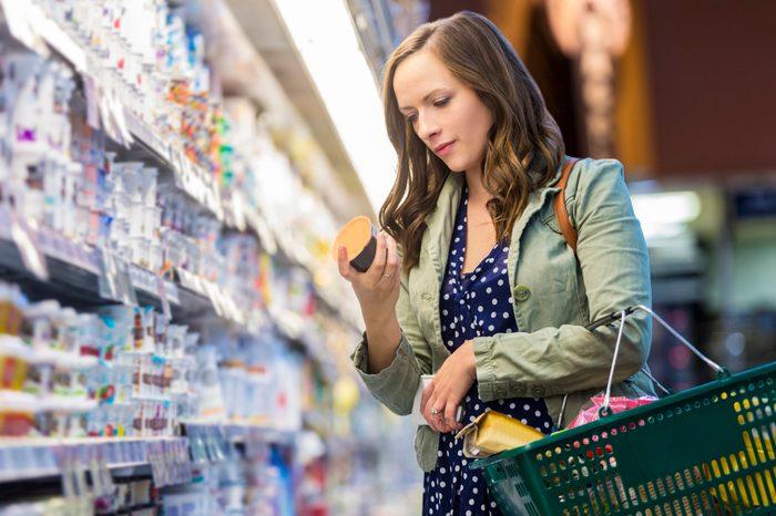 Gluten-free Diet   Celiac Disease   Gluten sensitivity   Gluten Intolerance   Woman reading food label at grocery store