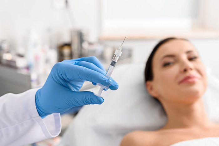 anti-aging advice   woman needle syringe botox procedure doctor