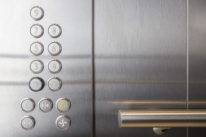 In the elevator floor buttons