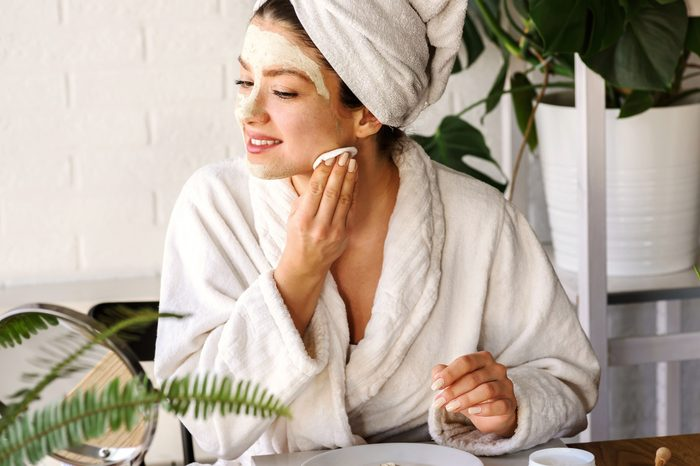 woman removing face mask