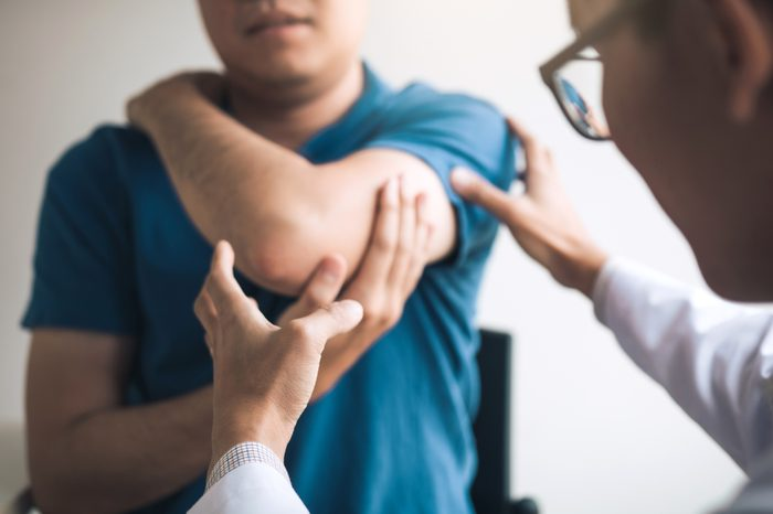 doctor checking patient's injury