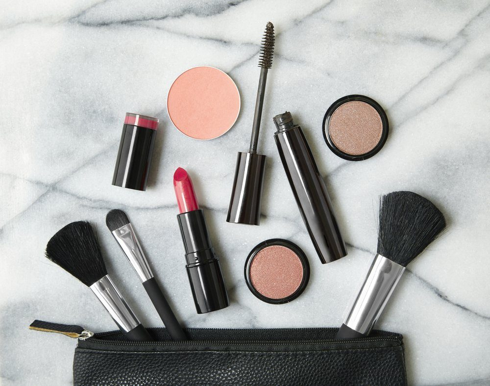 makeup bag with lipstick and other products