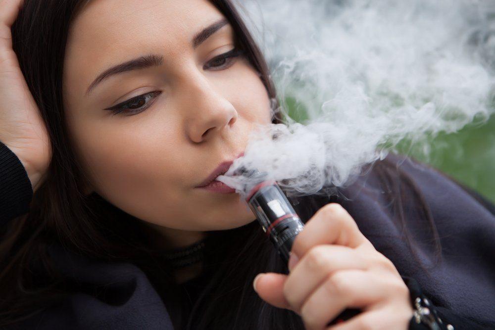 woman vaping, smoking e-cigarettes