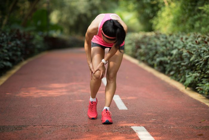 woman running with painful shin