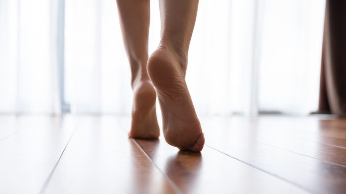 body facts   close up of woman's feet walking in home