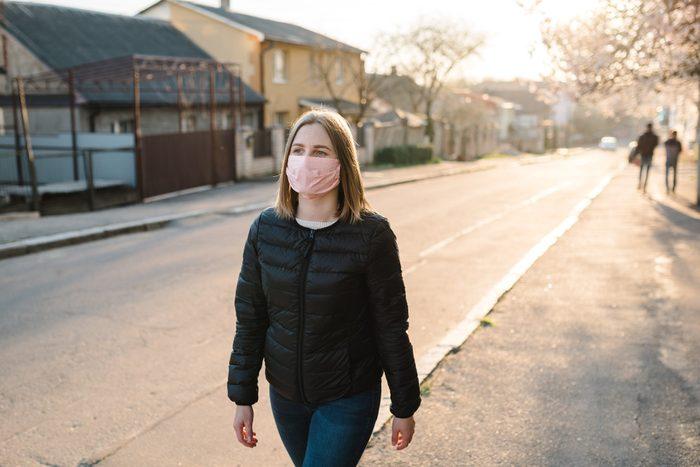 2020 | woman walking with mask on during coronavirus pandemic