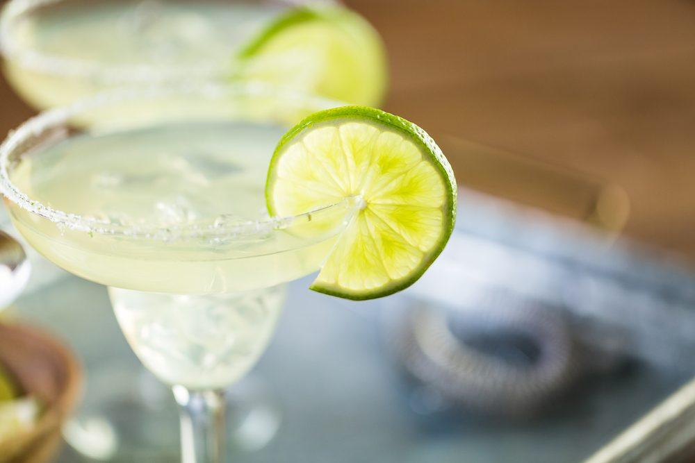 Key lime margarita garnished with fresh lime in margarita glass.