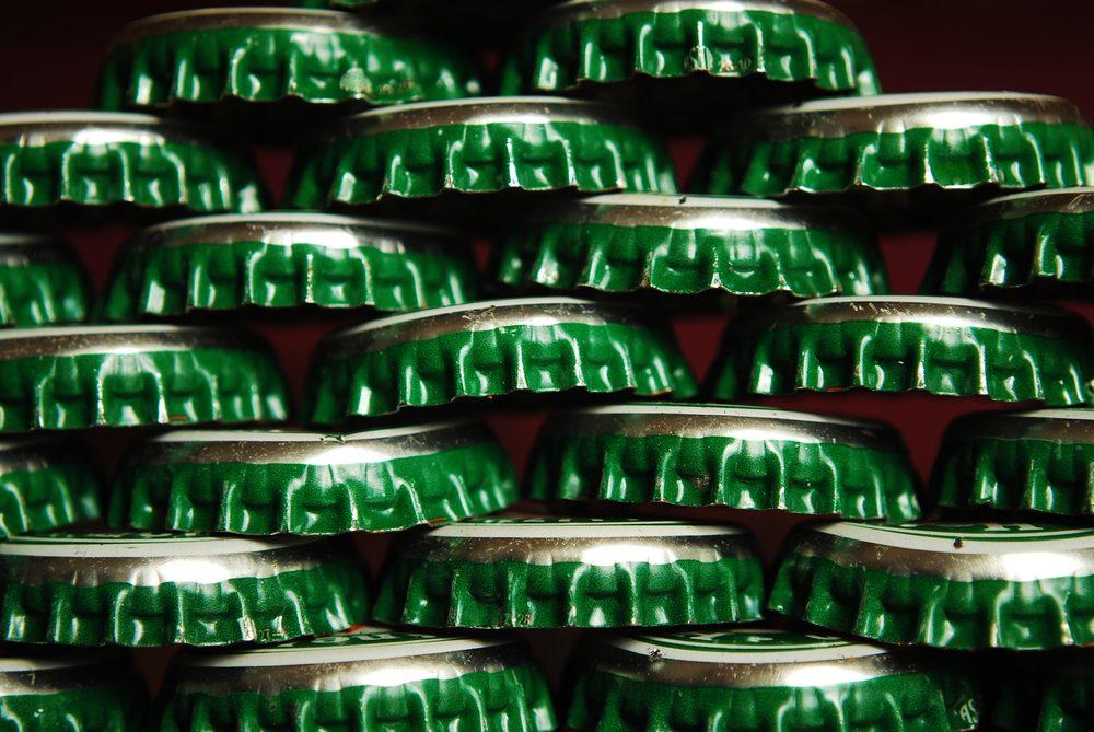 things that wreck your teeth   pile of green beer caps