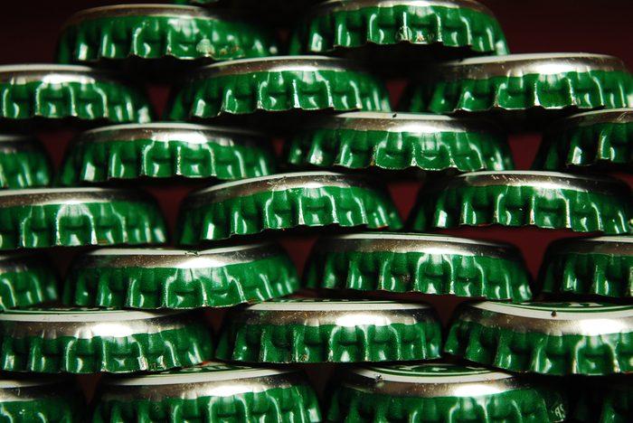 things that wreck your teeth | pile of green beer caps