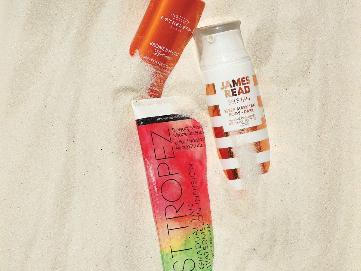 summer beauty products for skin and hair   beauty products in sand