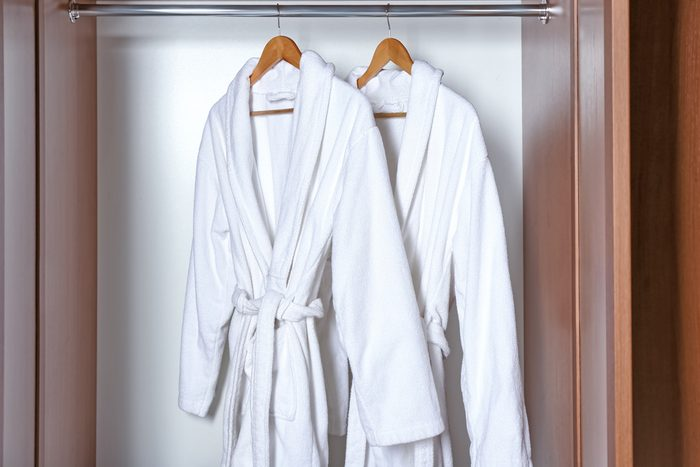 shouldn't be stored in the bathroom   Spa bathrobes hanging in wardrobe