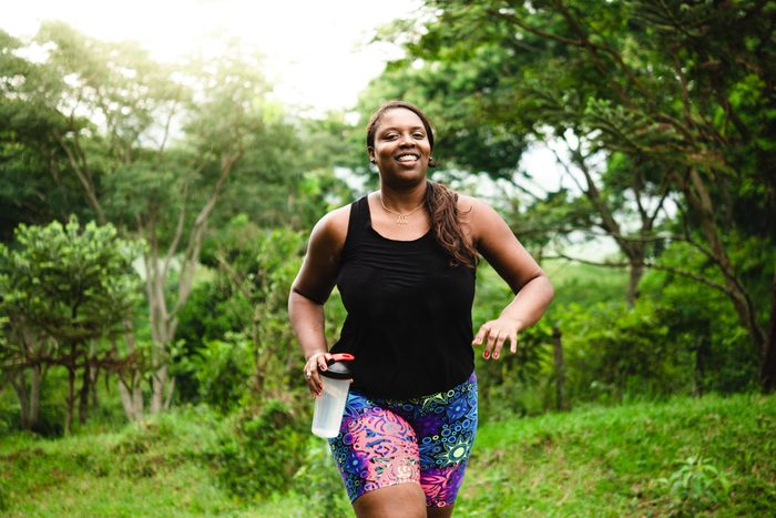 build muscle | woman walking and exercising in nature