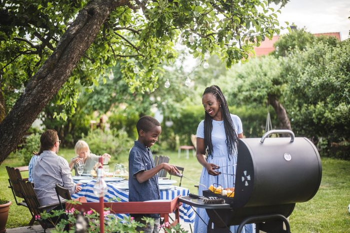 healthier grilling | mother and son grilling food for barbecue with family