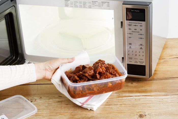 doctors eat for breakfast   woman heating leftovers in microwave