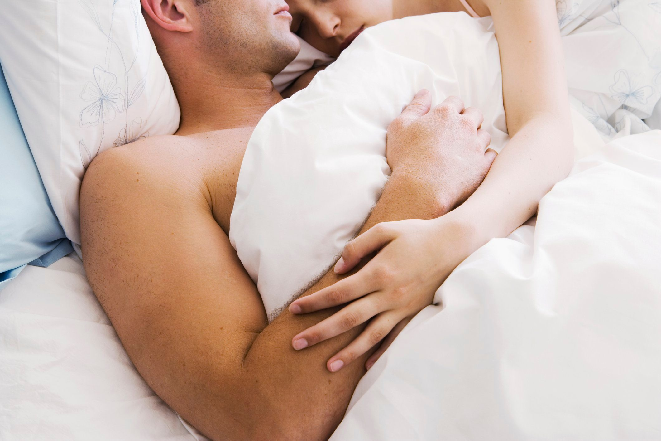 sex mistakes | couple holding each other in bed