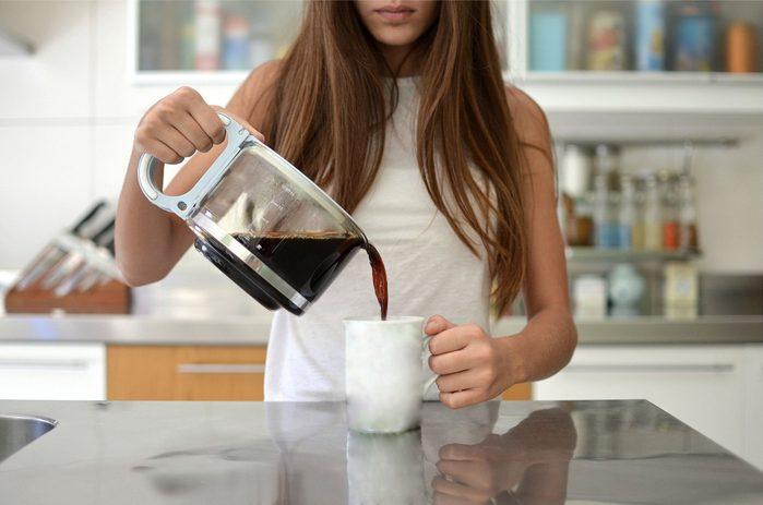 cause dehydration   woman pouring coffee into mug