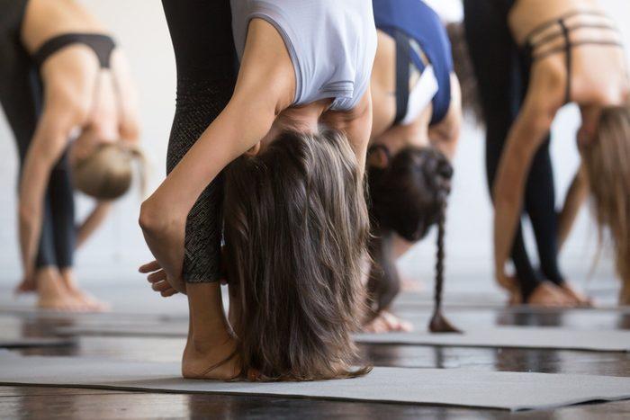 standing forward roll yoga
