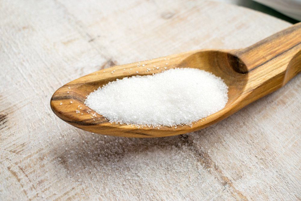foods and drinks that cause migraines | Artificial Sweeteners and Sugar Substitutes in wooden spoon. Natural and synthetic sugarfree food additive: sorbitol, fructose, honey, Sucralose, Aspartame
