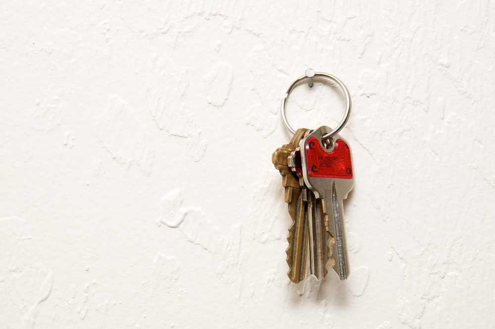 early-onset Alzheimer's | A keyring with three keys hanging on nail on wall.