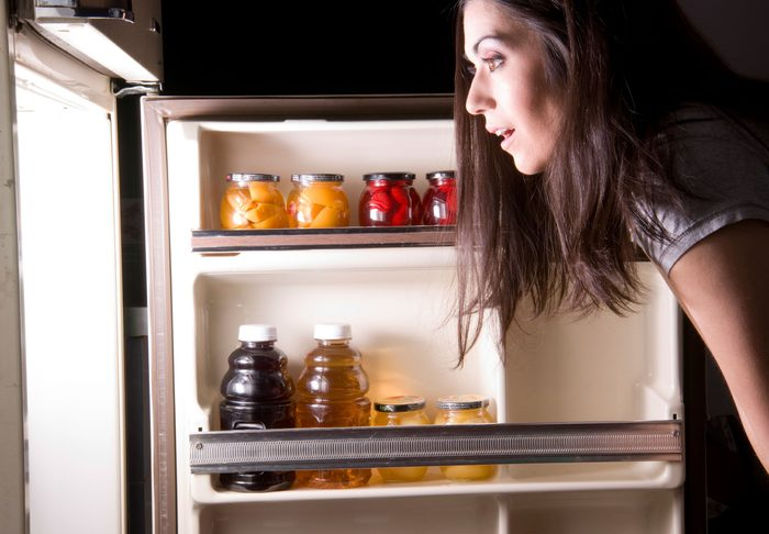 maintain a healthy weight   woman looking into a refrigerator
