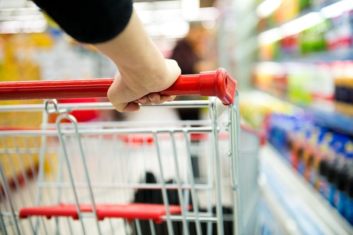 generic food brands   Closeup of woman with shopping cart
