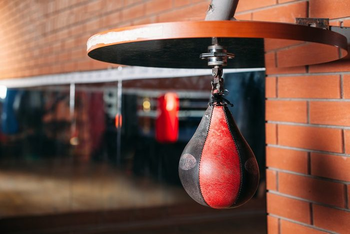 fitness after 50 | Black and red punching bag.