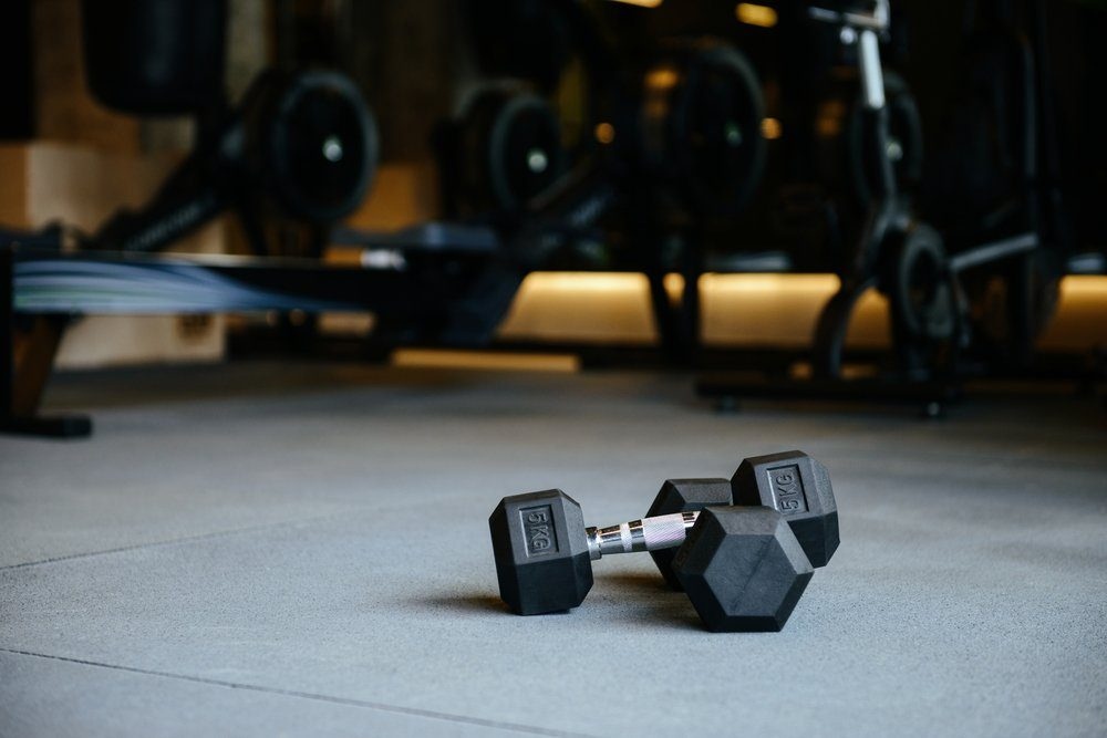 cause hemorrhoids | dumbbells which lying on the floor in gym