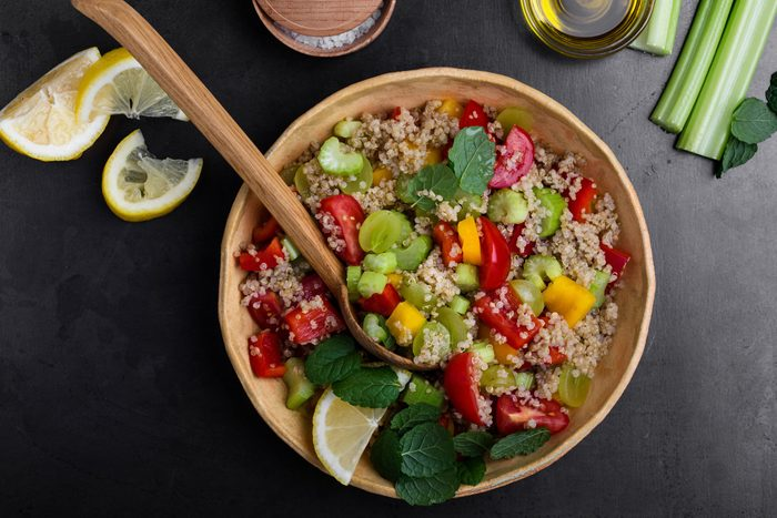 healthier grilling ideas | Quinoa salad with red and yellow bell peppers tomatoes, celery and grapes