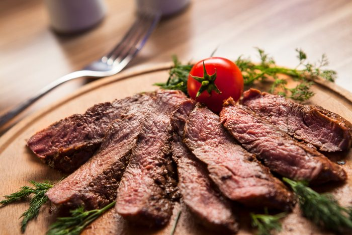 healthier grilling ideas | grilled steak on wood plate