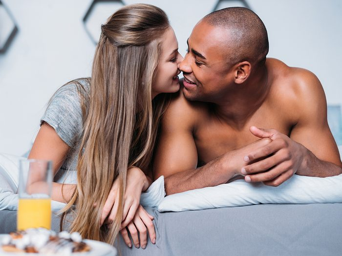 happy couple in bed | better sex