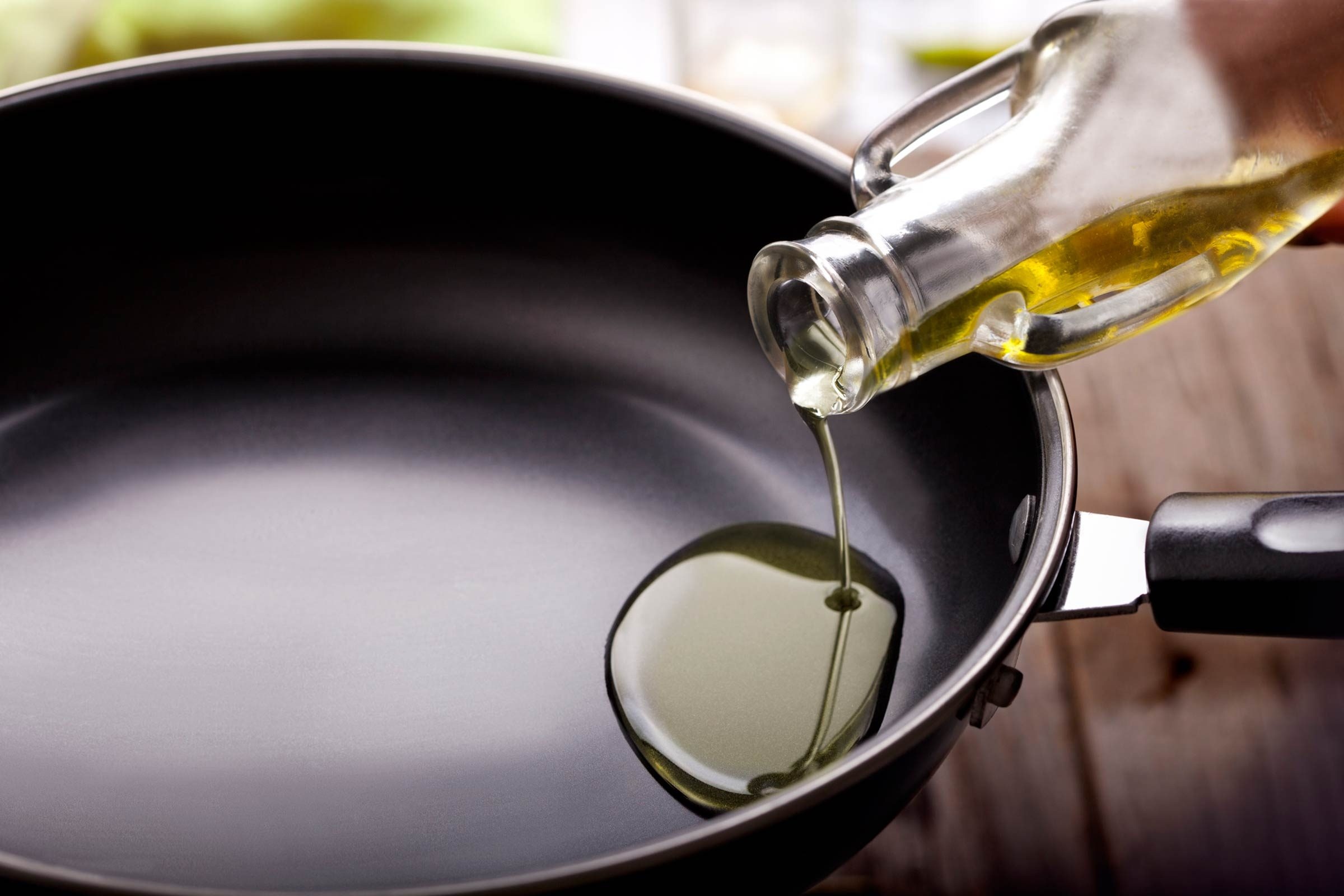 foods that lower your libido   oil being poured into a cooking pan