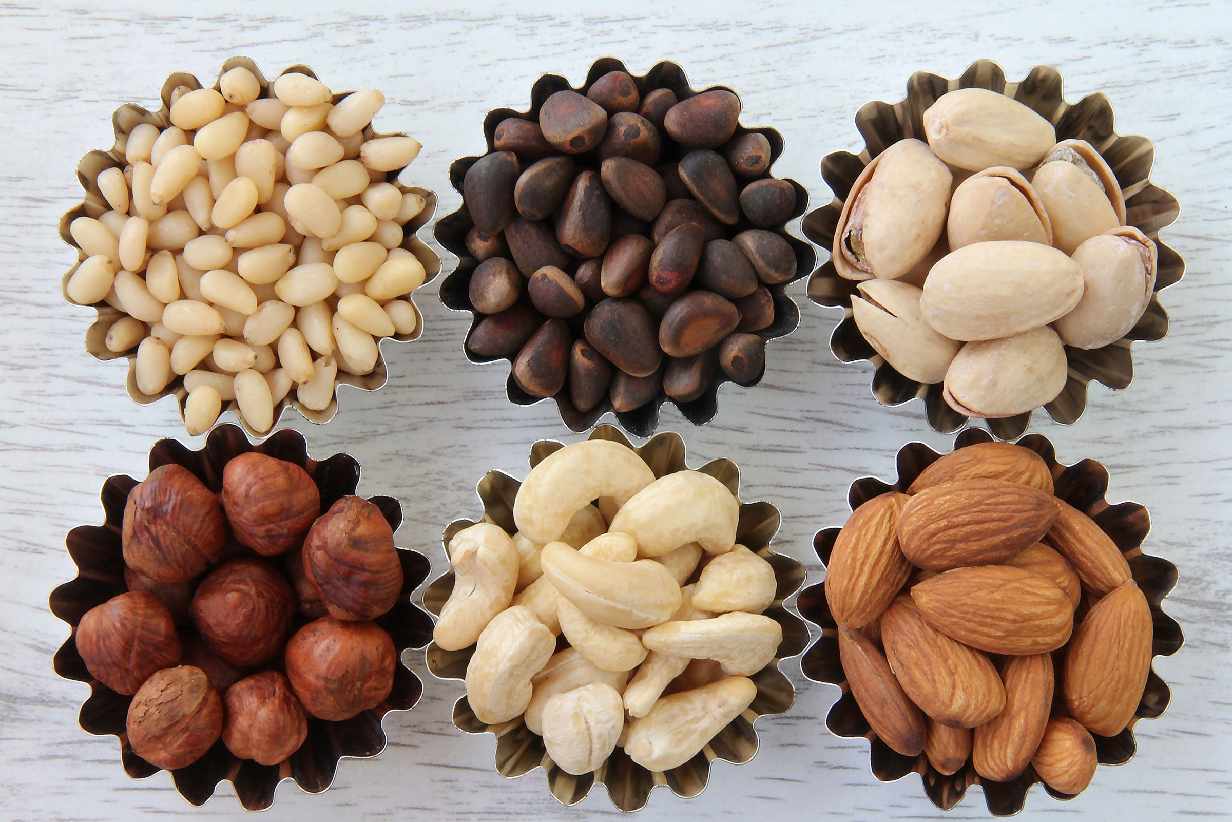 swollen feet | little cups of nuts including almonds, pine nuts, and pistachios