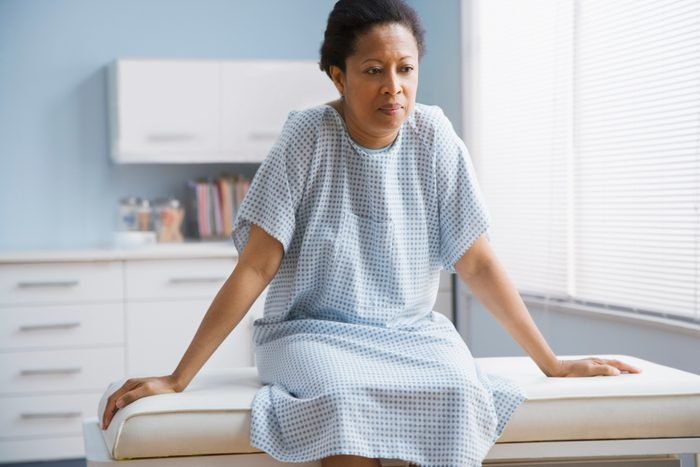 breast cancer prevention   female patient sitting on examination table in doctor's office