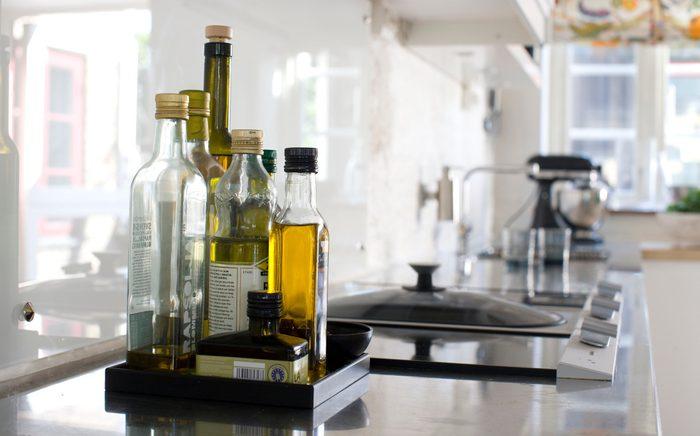 healthiest cooking oils | oil Bottles on kitchen worktop, close-up