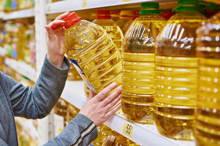 canola oil vs vegetable oil  Confused about the difference between canola and vegewoman taking large bottle of oil off of shelf at grocery store