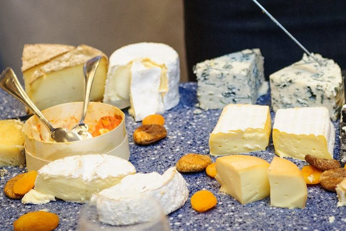 foods and drinks that cause migraines | Amazing selection of cheeses offered at table-side at a luxury hotel restaurant in Deauville, France.