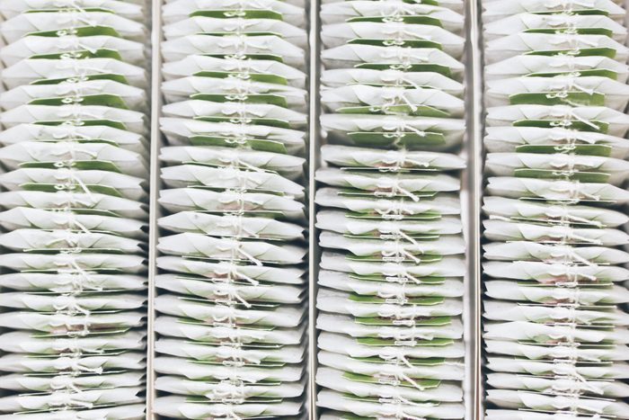 Close-up of teabags in a box from above