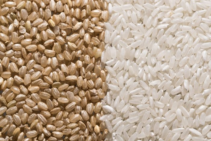Brown Rice vs. White Rice   shot of brown rice and white rice next to each other