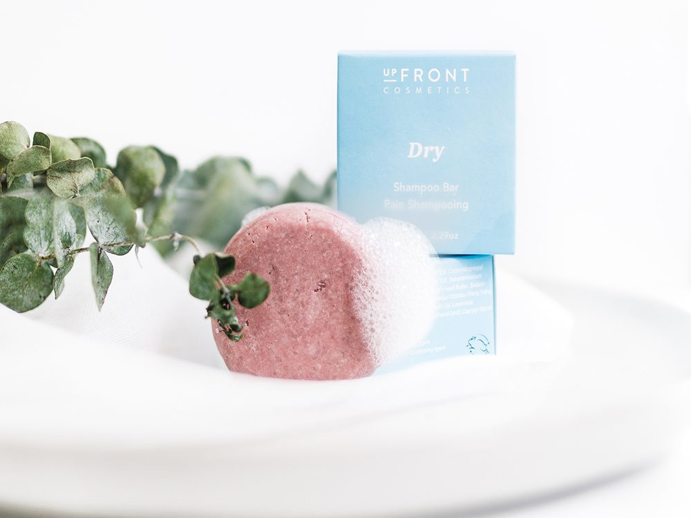 what are shampoo bars   upfront cosmetics shampoo bar on a sink lathered up