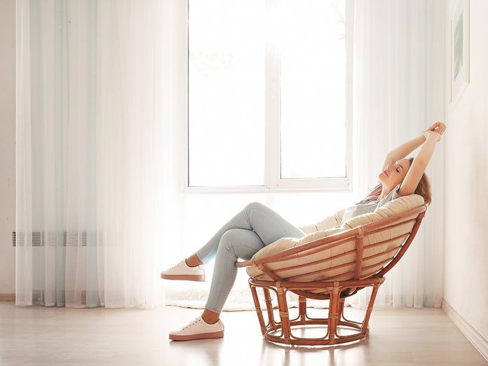 anxiety and distraction   woman sitting at home