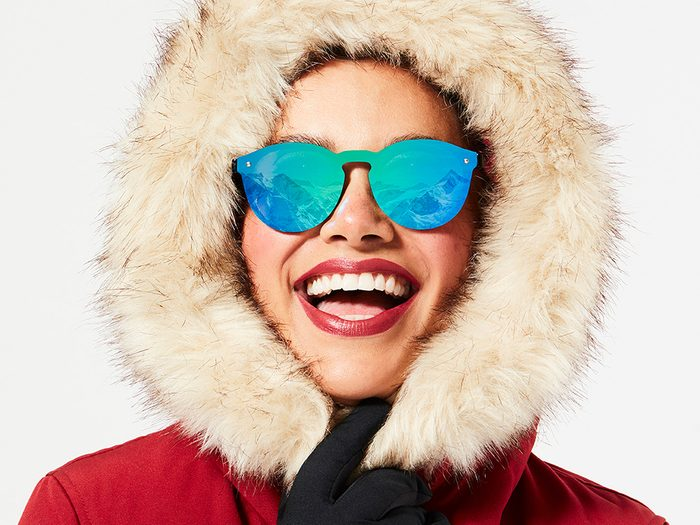 outdoor workout warm up and cool down | woman wearing sunglasses with a snowy reflection in them
