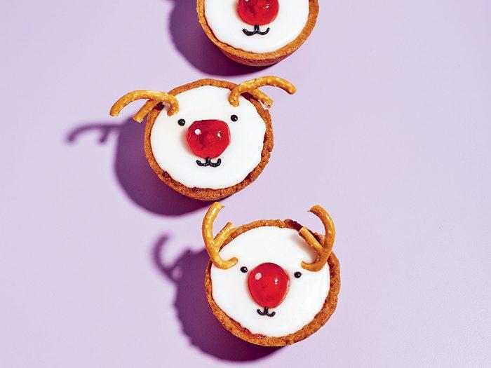 kim joy reindeer tarts | little reindeer cookies on a purple background